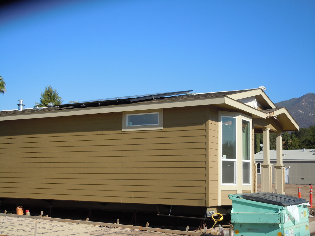 An ada aarp universally designed green solar powered home for Ada mobile homes